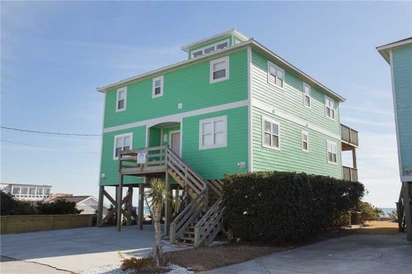 This large oceanfront home has ample parking and is located a short distance from restaurants and shopping in Atlantic Beach.