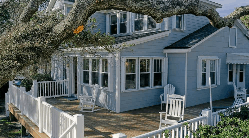 Whispering Oaks cottage view of deck || Spectrum Rental Properties