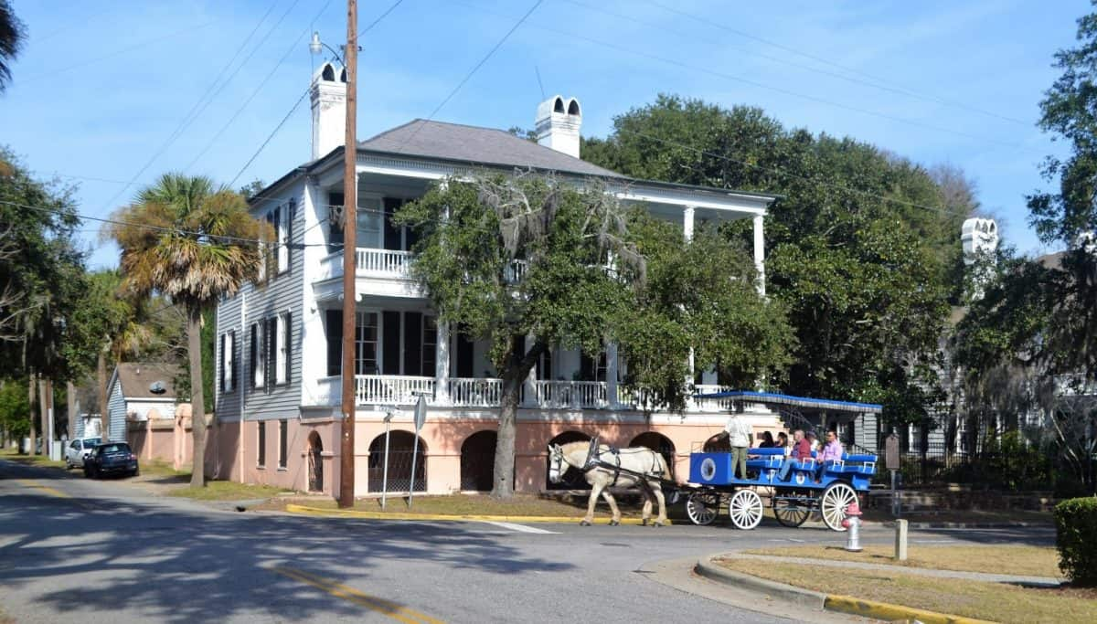 horse drawn carriage in front of a historic home in beaufort